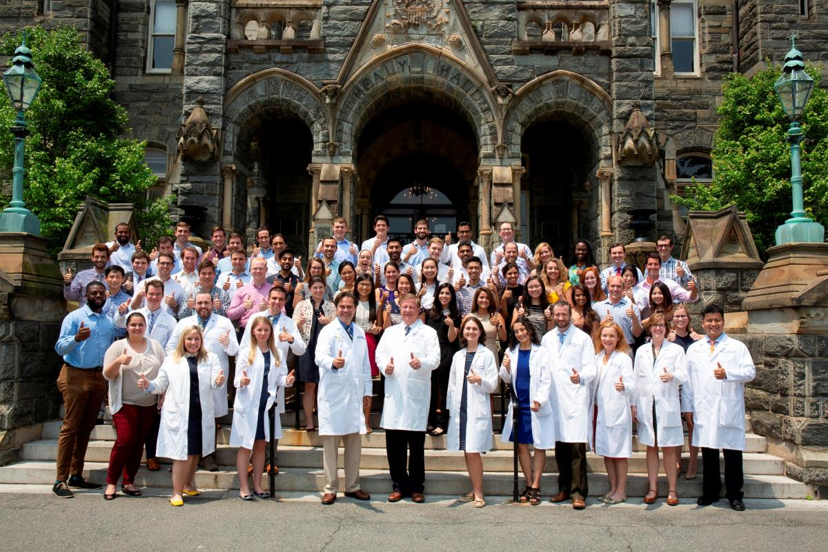 Group photo of internal medicine interns with their thumbs up