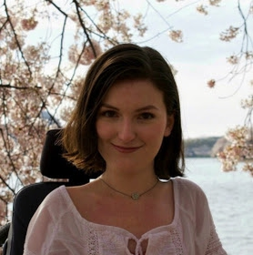 Anna Landre in front of Tidal Basin in with Cherry Blossoms in bloom